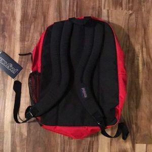 Jansport Bags - Jansport big student backpack nwt red